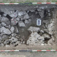 Fig. 9. Overhead photograph of the travertine masses exposed by the excavation in trench 5. (photo M. Holobosky)