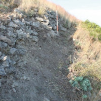Fig 11. Murgie upper city wall. Because of the external wall located in the valley, there is the nucleus of the wall with small stone size and back fill. Besides acting as defense equipment, it functions also as a containment wall. (Image by Author)