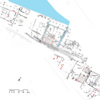 Fig. 14 The port area: warehouses, houses and burial (in red)