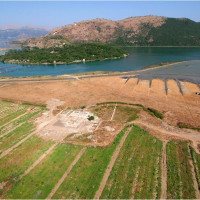 Fig. 1. Aerial shot of the excavations looking west across Butrint towards the Straits of Corfu (photo: Alket Islami)