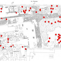 Fig. 1 Archaeological area La Fenice. A secondary crossroad is visible. The burials invaded this area and are distributed throughout the thickness of the layers, proving the cimiterial function for a long period (red dot). A central area free from burials can be noticed: this space can be explained by the presence of a church as the historical sources report, but a localization is not possible. The interpretation is complicated by the fact that this area has undergone several radical interventions, such as the construction of the sixteenth-century walls and the presence of the eighteenth–century theatre La Fenice which was located here until the 1930 earthquake.